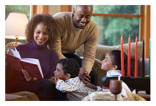 Black family reading about Kwanzaa
